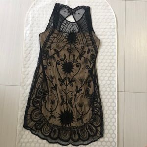 Black dress with embroidered flowers.